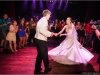 crowd-surrounds-bride-and-groom-on-dance-floor-at-detroit-wedding-reception