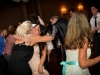 delighted-bride-and-friend-embrace-at-toledo-wedding-reception